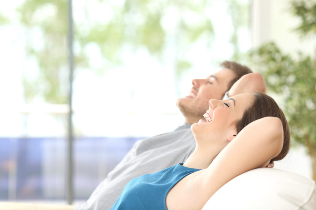 a relaxing couple after using services from our mold remediation company in Glastonbury